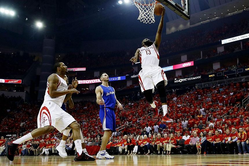 James Harden #13 of the Houston Rockets shoots against the Los Angeles Clippers in the first quarter during Game Seven of the Western Conference Semifinals at the Toyota Center in Houston on May 17, 2015. -- PHOTO: AFP
