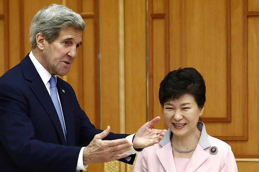 US Secretary of State John Kerry (left) talking to South Korean President Park Geun Hye at the Presidential Blue House in Seoul, South Korea on May 18, 2015. -- PHOTO: EPA