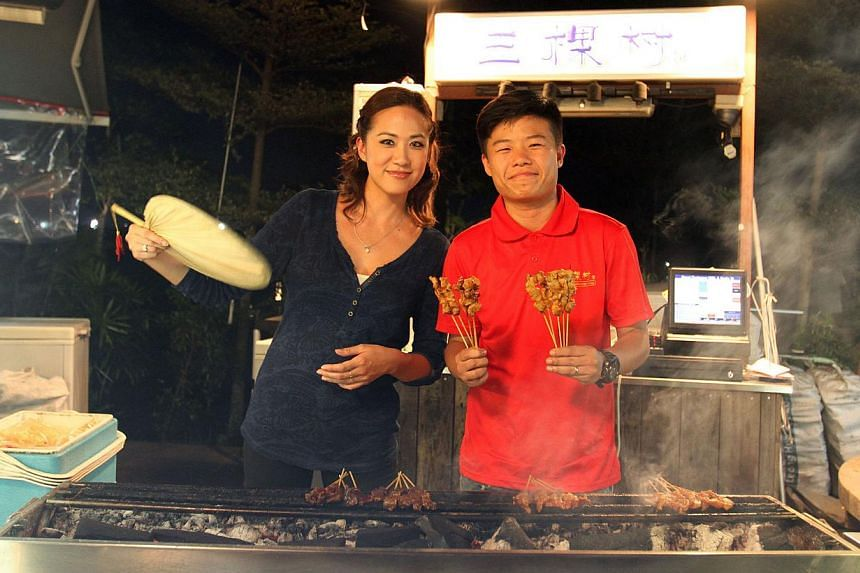 Food Wars Asia host Michele Lean (left) with Mr Anon Foo (right), who owns Wu Ke Shu Satay at Satay By The Bay in Marina Gardens Drive, and Mr Douglas Ng of Fishball Story in Golden Mile Food Centre. Both stalls have seen new customers since the show