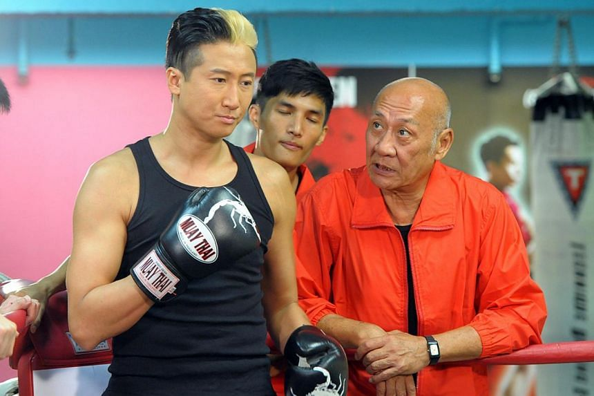 Hong Kong actor Timmy Hung (left, with boxing gloves) and a photo of his second son, nicknamed Little JT. -- PHOTO: TVB