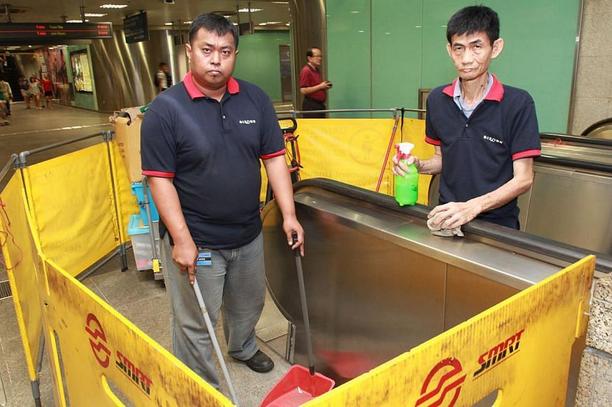 Bizlink managed to find higher-paying jobs such as cleaning escalators at MRT stations for clients like Zali Samat (left) and Kwok Yeow Seng. Madam Seng Siew Thim, 53, and her brother Seng Beng Tee, 49, recycling headsets at a Minds workshop.