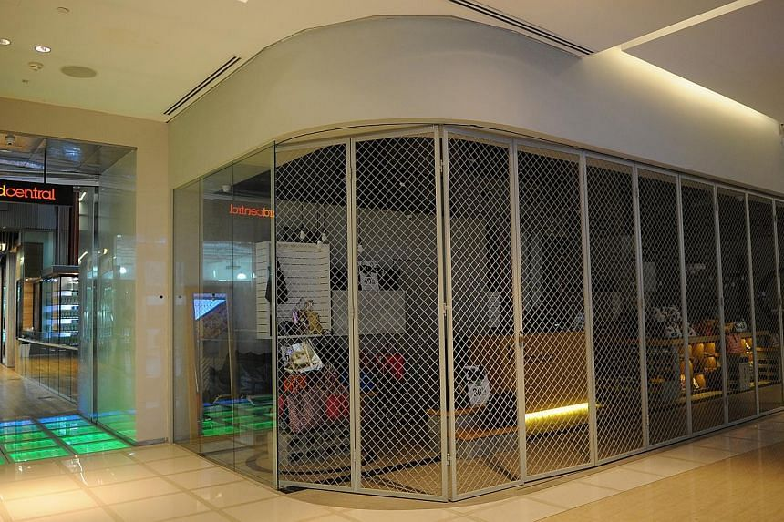 The shutters have come down on at least five shops in Orchard Gateway (left and above). Retailers complain about insufficient signs and poor marketing. The mall's information counter (left) is located on the fourth floor, which is of little help to l
