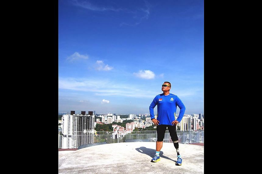 Paralympian Shariff Abdullah taking in the Singapore skyline from the vantage point of the sky garden at the top of Pinnacle@Duxton.
