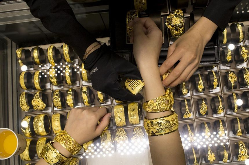 "Phillip Futures investment analyst Howie Lee says gold prices are likely to pick up ""in the very long run"", especially as ""global economic recovery ramps up jewellery demand in China and India""."