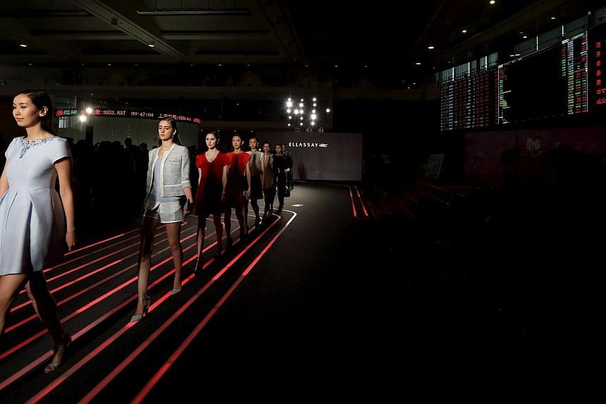 Models presenting creations from Ellassay, a women's apparel company, at the Shanghai Stock Exchange following its IPO last month. The Chinese city's booming exchange boasted 35 IPOs that raised about US$5.4 billion (S$7 billion) in the first quarter
