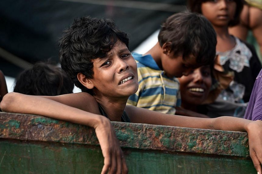 A Rohingya migrant crying as he sits with others in a boat drifting in Thai waters off the southern island of Koh Lipe in the Andaman Sea, on May 14, 2015. Malaysia's National Security Council chairman Shahidan Kassim has defended the country against