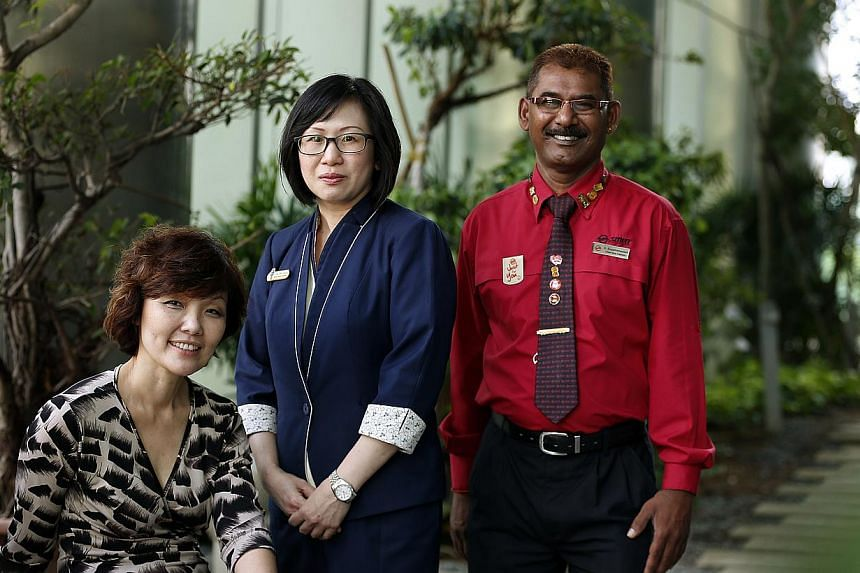 (From left) Ms Lynette Low, senior manager from Canon Singapore, Ms Tan Bee Leng, deputy service manager at at POSB's Woodlands branch; and SMRT chief bus captain D. Suppiramaniam, who received theIndividual Medallion award at theSingap