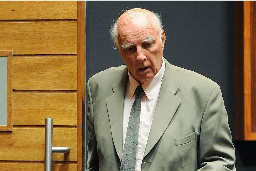 Australian-born former tennis Grand Slam champion Bob Hewitt walks through the Palm Ridge court where he was found guilty of rape and indecent assault on March 23, 2015 in Johannesburg. Hewitt was sentenced to six years in jail in South Africa o