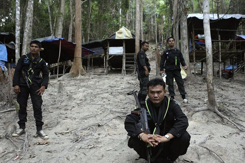 Thai soldiers secure the area next to shelters after discovering another abandoned jungle camp believed used by the human traffickers to detain Rohingya migrants at a mountain in Sadao, Thai-Malaysian border district, Songkhla province, southern Thai