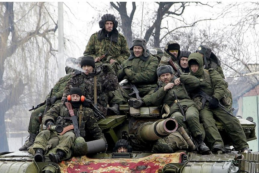 Members of the armed forces of the separatist self-proclaimed Donetsk People's Republic drive a tank on the outskirts of Donetsk, Ukraine, in this Jan 22, 2015 file photo.The Kremlin reiterated on Monday, May 18, that there were no regular Russ