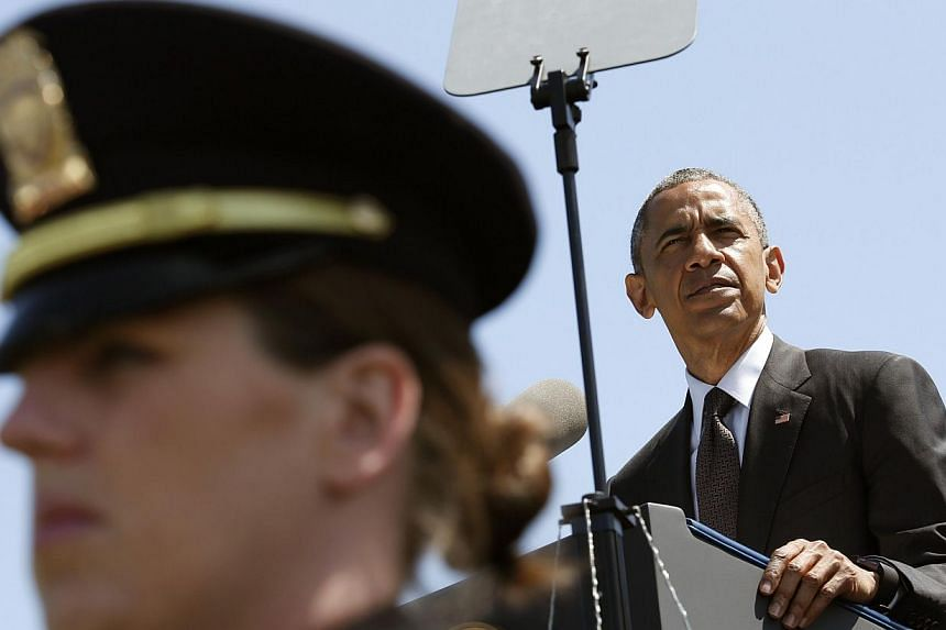 US President Barack Obama delivers remarks at the 34rd Annual National Peace Officers' Memorial Service on Capitol Hill in Washington, DC on May 15, 2015.Mr Obama plans to put in place new restrictions on the use of military equipment by police