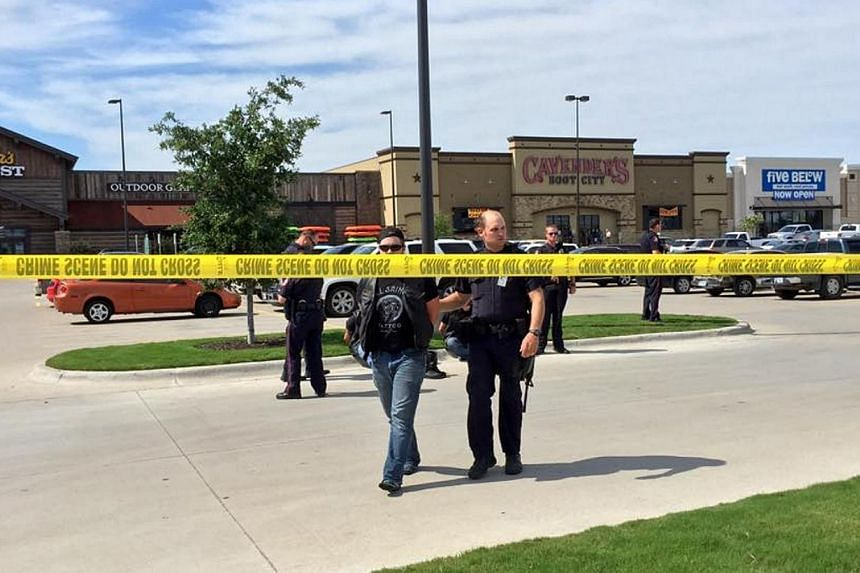 Police escort a man at the scene of a shooting in Waco, Texas, in this handout photo provided by the Waco Police Department on May 17, 2015.Police in Waco, Texas said on Monday, May 18, that 192 people were being arrested in connection wi
