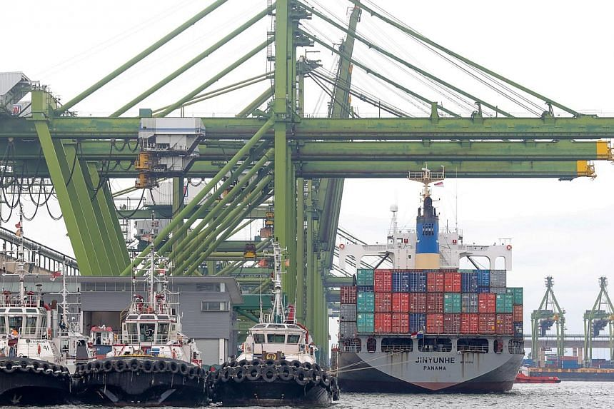 A container ship berthed at the Port of Singapore Authority's (PSA) Pasir Panjang Terminal. According to a Reuters poll, Singapore's non-oil domestic exports (NODX) are forecast to have fallen in April. -- PHOTO: ST FILE