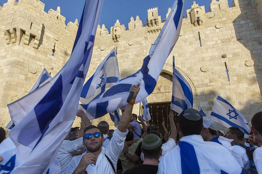 Israelis stop to sing and dance as they stop outside the Damascus Gate in East Jerusalem before marching into the Moslem Quarter of Jerusalem's Old City on Jerusalem Day on Sunday 17 May 2015. -- PHOTO: EPA