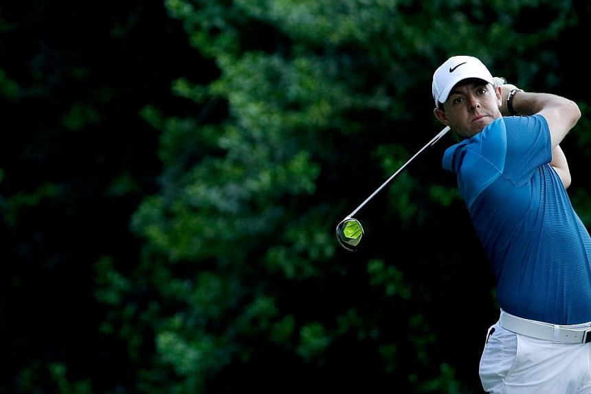 Rory McIlroy of Northern Ireland tees off on the 14th hole during the final round at the Wells Fargo Championship at Quail Hollow Club on Sunday in Charlotte, North Carolina in the US. -- PHOTO: AFP