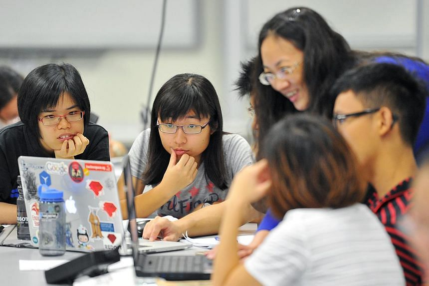 First-year undergraduates during a physics class at the Singapore University of Technology and Design (SUTD) on May 15, 2015. -- PHOTO: LIM YAOHUI FOR THE STRAITS TIMES