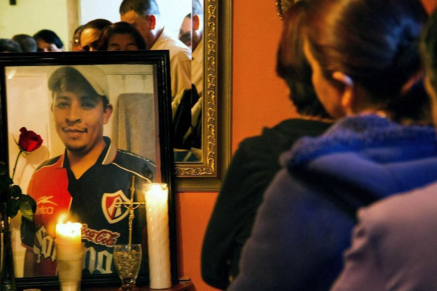 Relatives and friends of Mexican Ruben García Villalpando taking part in a mass at his sister's house, in the town of Nuevo Porvenir, in Durango State on Feb 28 2015. -- PHOTO: AFP