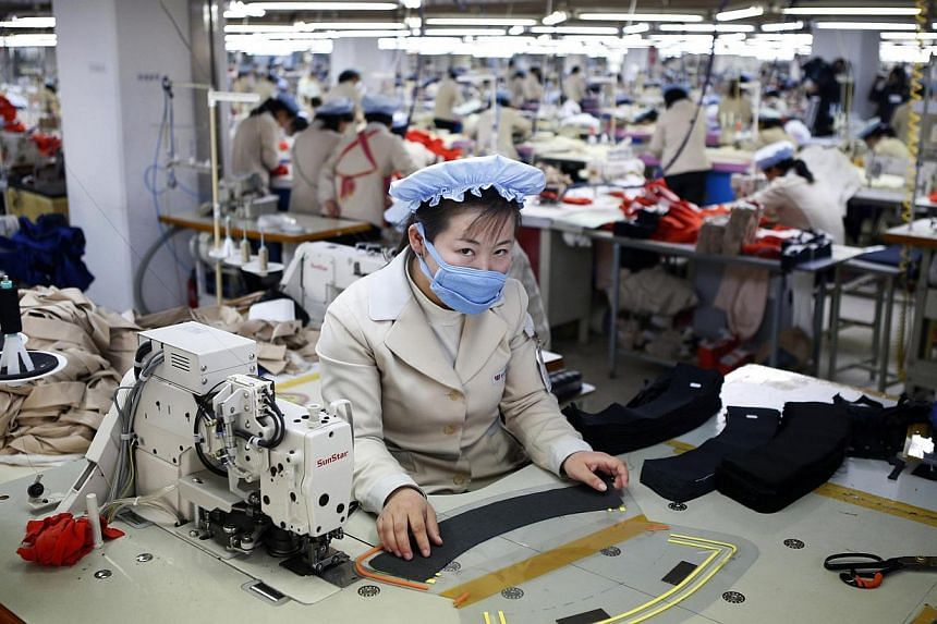 A North Korean employee works in a factory of a South Korean company at the Joint Industrial Park in Kaesong industrial zone on Dec 19, 2013. United Nations Secretary-General Ban Ki Moon has announced he will pay a visit to the the Kaesong Industrial