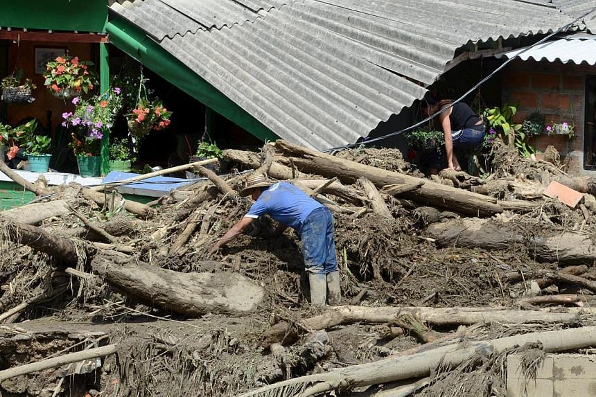 A man clearing rubble from the ruins of his house, after a landslide sent mud and water crashing onto homes in the municipality of Salgar in Antioquia department on May 18, 2015. -- PHOTO: REUTERS
