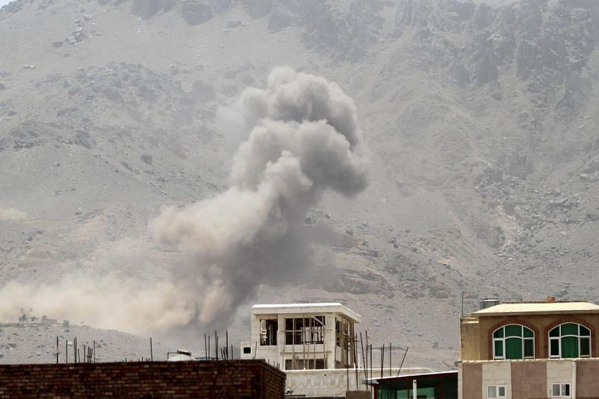 Smoke billows from Noqum mountain after it was hit by an air strike in Yemen's capital Sana'a on May 19, 2015. Yemeni political factions voiced support Tuesday for Saudi-led forces fighting Iran-backed rebels, calling for safe zones in the war-t