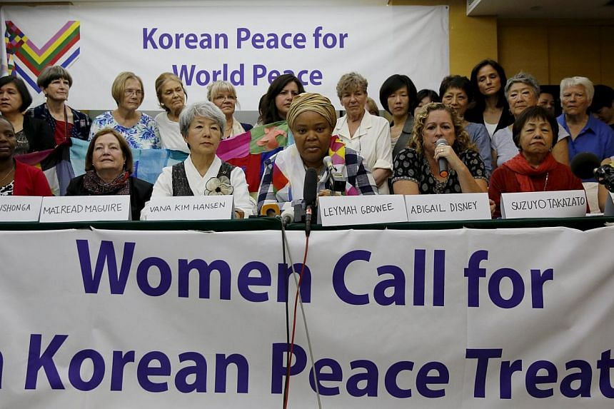 Members of the WomenCrossDMZ group attending a news conference before they leave for North Korea's capital Pyongyang, at a hotel in Beijing, China, on May 19, 2015. -- PHOTO: REUTERS
