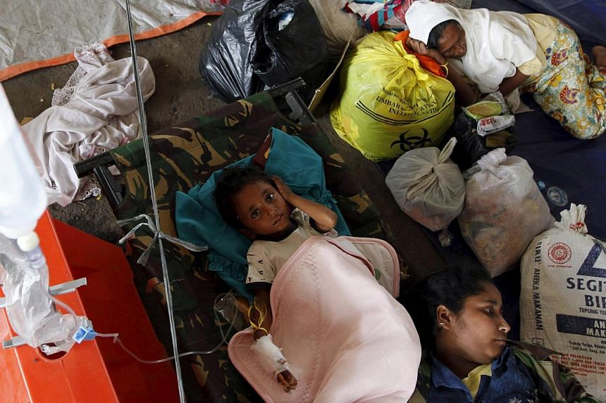 Rohingyas from Myanmar receiving medical assistance at a shelter in Kuala Langsa, Aceh province, on Sunday. Indonesia has taken in about 1,400 immigrants in Aceh, but say that many migrants it encounters are bound for Malaysia. So far, there are over