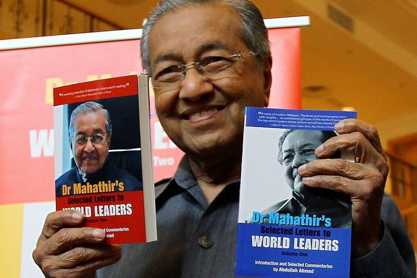 Dr Mahathir Mohamad with his new book Selected Letters To World Leaders. The former Malaysian premier has been PM Najib Razak's harshest critic and has campaigned to remove him as Umno president.