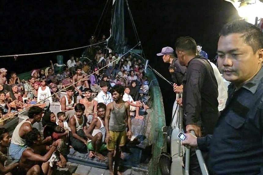 A Royal Thai Navy handout photo made available on 19 May 2015 shows some 450 ethnic Rohingya migrants believed to be from Myanmar and Bangladesh on a boat, which was abandoned by it's captain and crew, being inspected by Thai navy officers in the And