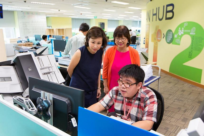 (From left) UOB Group head of technology and operations Susan Hwee, Autism Resource Centre president Denise Phua and UOB Scan Hub clerical assistant Feng Zhi Hua. People with autism account for about one-third of the 53 employees at the Scan Hub, whe