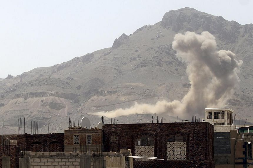 Smoke billows from Noqum Mountain after it was hit by an air strike in Yemen's capital Sana'a on May 19, 2015. -- PHOTO: REUTERS