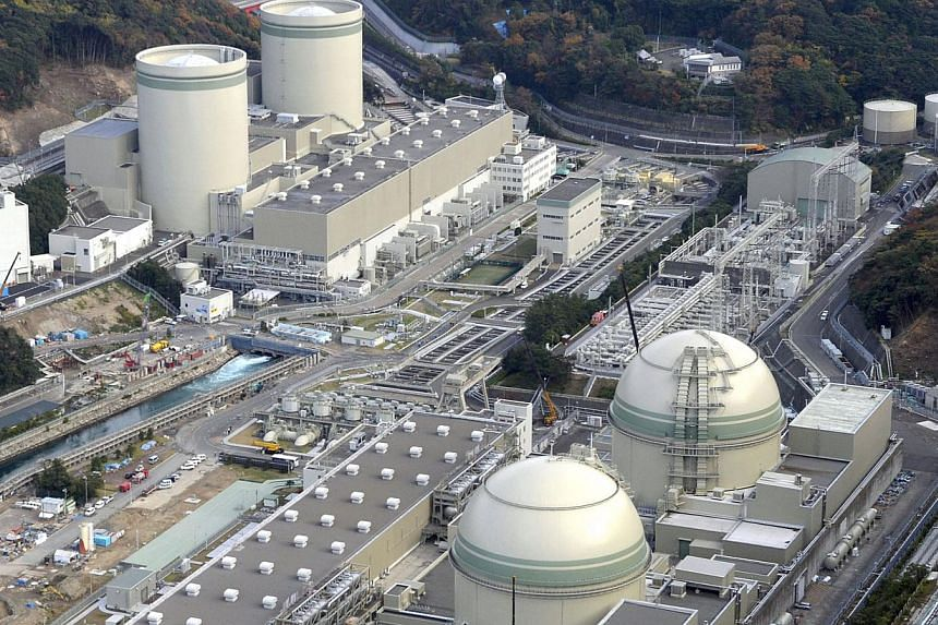 An aerial view shows No. 4 (front left), No. 3 (front right), No. 2 (rear left) and No. 1 reactor buildings at Kansai Electric Power Co.'s Takahama nuclear power plant in Takahama, Fukui prefecture,on Nov 27, 2014.A Japanese court upheld