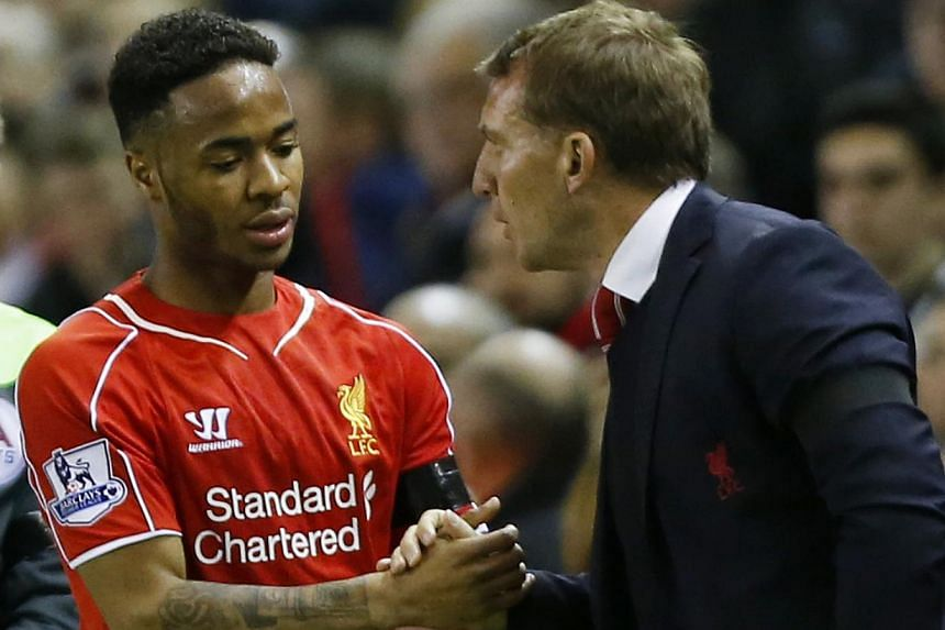 Liverpool winger Raheem Sterling (left) could add to manager Brendan Rodgers' (right) Anfield woes, as speculation mounts that he could hand in a transfer request. -- PHOTO: REUTERS