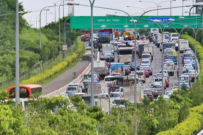A snaking traffic jam in the area took at least three hours to clear after the crash. -- PHOTO: SHIN MIN DAILY NEWS