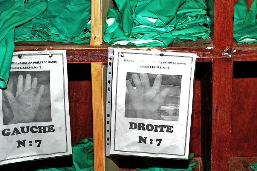 Protective gloves are pictured at the Donka Ebola treatment center on May 2, 2015 in Conakry, Guinea. Ebola has spread further in Guinea and Sierra Leone, with 36 cases in the past week, four times as many cases as the week before, the World He