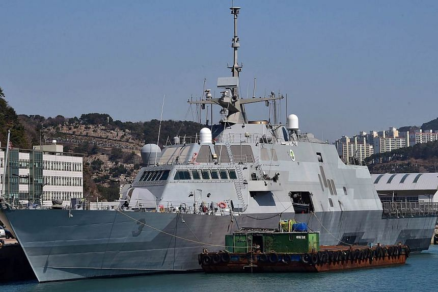 The U.S. Navy's Littoral Combat Ship USS Fort Worth (LCS 3) is seen moored at at a naval port in Busan on March 14, 2015. The USS Fort Worth used agreed codes for unplanned encounters when it met a Chinese vessel during a recent patrol of the