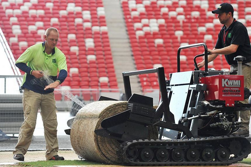 The entire process, from nursery to an event-ready field at the stadium, will take 48 hours. -- PHOTO: LIM YAOHUI FOR THE STRAITS TIMES