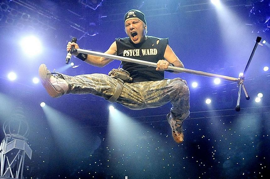 Charismatic frontman Bruce Dickinson roared and amped up the mood with his vocal histrionics and antics during heavy-metal band Iron Maiden's concert at the Singapore Indoor Stadium in 2011.-- PHOTO:SPH