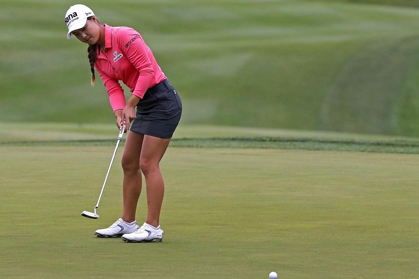 Minjee Lee of Australia putts for birdie on the 18th hole during the continuation of final round of the Kingsmill Championship presented by JTBC on the River Course at Kingsmill Resort on Monday in Williamsburg, Virginia in the US. -- PHOTO: AFP