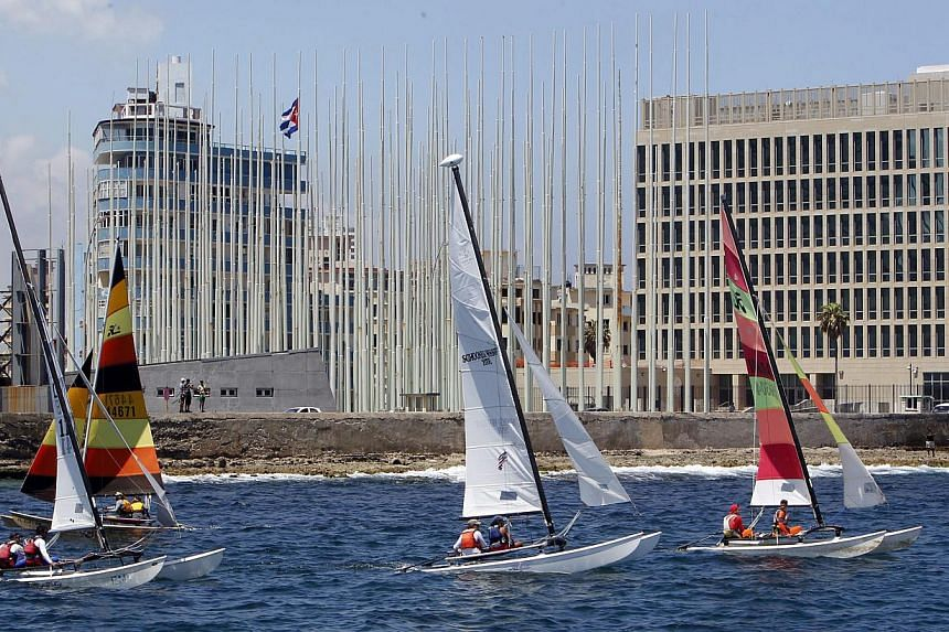 Participants from Cuba and the US competing in a regatta in Havana on May 19, 2015. It is the first regatta since the two countries' decision to seek normal ties after more than five decades of Cold War strains. -- PHOTO: EPA