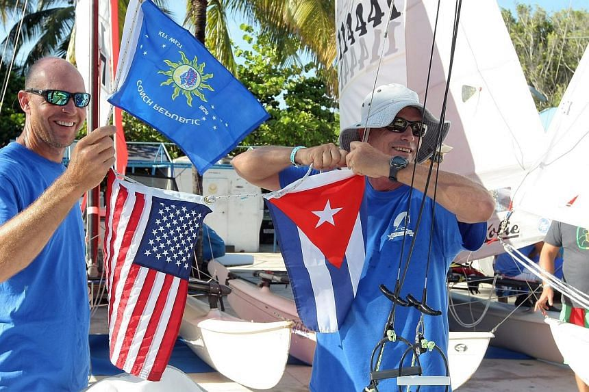 Cuban and US teams preparing for a regatta in Havana, Cuba, on May 19, 2015. It is the first regatta since the two countries' decision to seek normal ties after more than five decades of Cold War strains. -- PHOTO: EPA