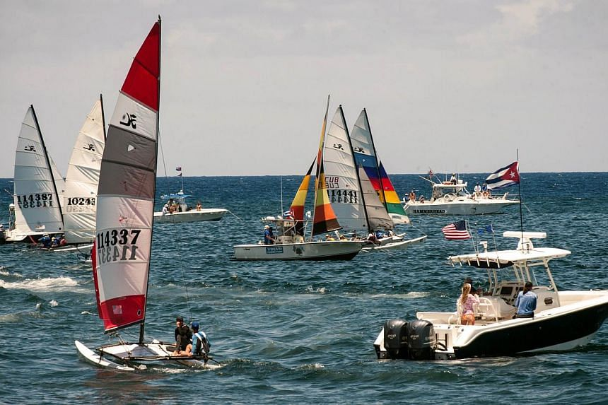 Competitors taking part in the Havana Challenge regatta in Havana on May 19, 2015. It is the first regatta since the two countries' decision to seek normal ties after more than five decades of Cold War strains. -- PHOTO: AFP