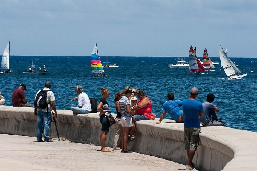 People watching the Havana Challenge regatta in Havana on May 19, 2015. It is the first regatta since the two countries' decision to seek normal ties after more than five decades of Cold War strains. -- PHOTO: AFP