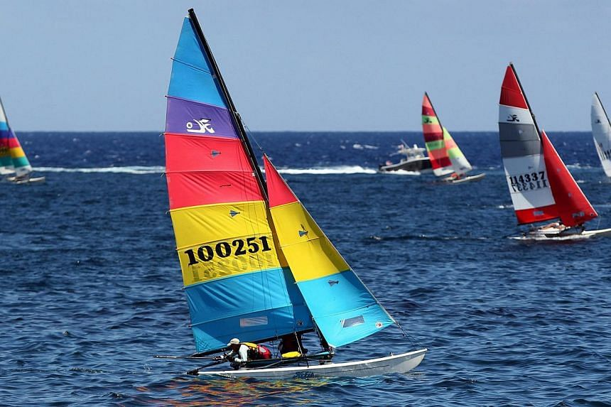 Catamarans from the US and Cuba competing in a regatta at the Malecon in Havana on May 19, 2015. It is the first regatta since the two countries' decision to seek normal ties after more than five decades of Cold War strains. -- PHOTO: EPA