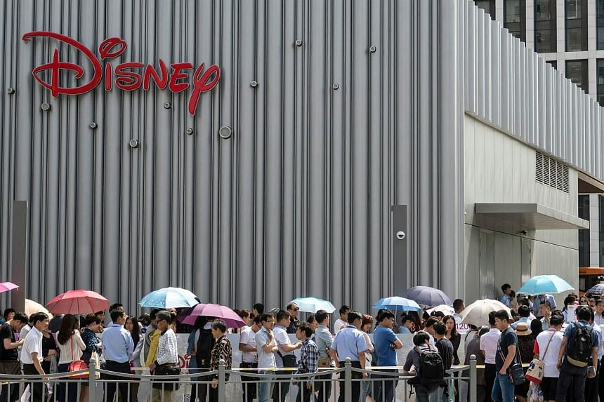 People queue to enter China's first Disney flagship store at the Lujiazui financial district in Shanghai on May 20, 2015. -- PHOTO: AFP