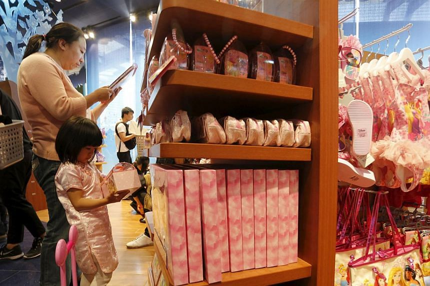 A woman and a girl shop inside China's first Disney store at Pudong financial district in Shanghai on May 20, 2015. -- PHOTO: REUTERS