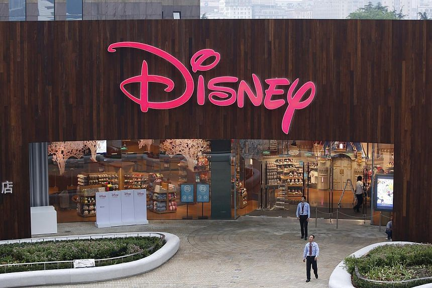 Security guards stand in front of China's first Disney store at Pudong financial district in Shanghai on May 18, 2015. -- PHOTO: REUTERS