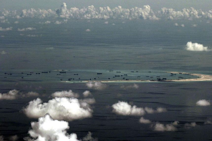 This aerial photograph taken from a military aircraft shows alleged ongoing reclamation by China on Mischief Reef in the Spratly group of islands in the South China Sea, west of Palawan, on May 11, 2015. -- PHOTO: AFP