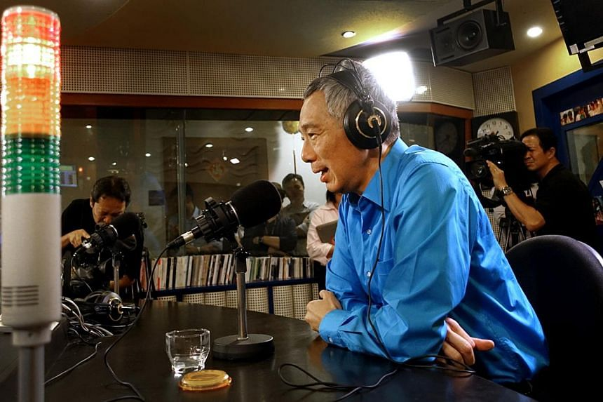 PM Lee Hsien Loong speaking on Capital 95.8 FM's live weekly programme On Air With Minister last night, where he urged Singaporeans not to take their votes lightly.