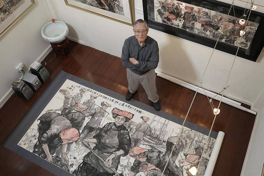 Watercolourist Tong Chin Sye with Toiling For Our Loved Ones, his largest work at the exhibition.