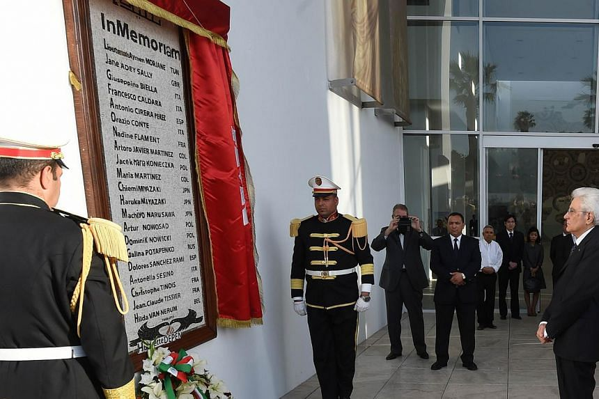 Italian President Sergio Mattarella (right) lays a wreath at a monument displaying the names of those killed in the Bardo Museum attack, during his visit to Tunis on May 18, 2015. Italian police have arrested a Moroccan man suspected of taking part i